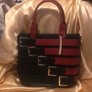 I'm selling a brand new black and red classy purse